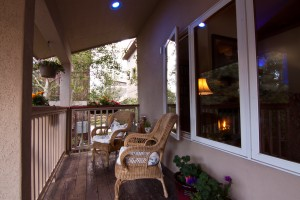Enjoy the peaceful surroundings of the sitting area on the front porch
